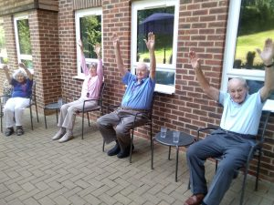 Rockdale House residents enjoy exercise on the patio